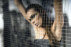 Girl in jail Stock Photo