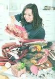 Girl with jamon and sausage Stock Photo