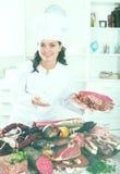 Girl with jamon and sausage Royalty Free Stock Photography