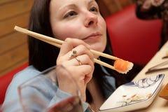 Girl in japan restaurant. The girl eats sushi in japan restaurant Royalty Free Stock Images