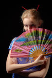 Girl in japanese dress. With fan on black background Royalty Free Stock Images