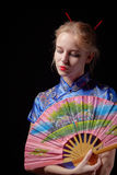 Girl in japanese dress. With fan on black background Royalty Free Stock Photos