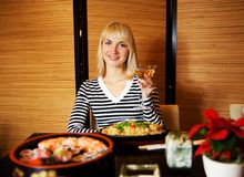 Girl in Japaneses restaurant Royalty Free Stock Image