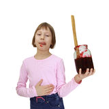 Girl with a jar of jam Stock Image