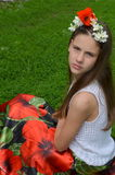 Girl with jasmine flowers and poppies Stock Images