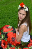 Girl with jasmine flowers and poppies Stock Photo
