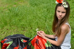 Girl with jasmine flowers and poppies Royalty Free Stock Photography