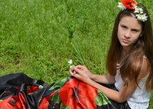 Girl with jasmine flowers and poppies Royalty Free Stock Images