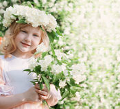 Girl with jasmine outdoor Royalty Free Stock Photography