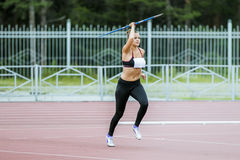 Girl javelin thrower. Chelyabinsk, Russia - July 10, 2015: girl javelin thrower attempts during Championship of Chelyabinsk on track and field athletics Royalty Free Stock Photo