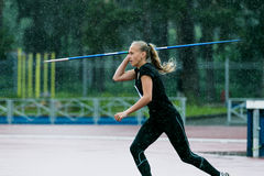Girl javelin thrower in competition Royalty Free Stock Photography