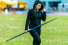 Girl javelin thrower in competition Stock Photo
