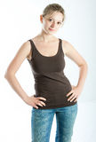 The girl in jeans. Beautiful young girl in jeans and a vest stock photography