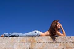 Girl in jeans. Topless girl in blue jeans Stock Image