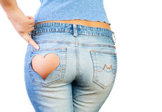 Girl in jeans. With heart-shaped hole on the buttock, indicates the finger Royalty Free Stock Photo