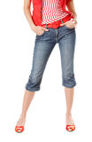 Girl in jeans. Girl with long beautiful legs in jeans with red shoes Royalty Free Stock Photos