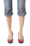 Girl in jeans. Girl with long beautiful legs in jeans and jeans shoes Stock Image
