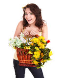Girl in jeans with basket wild flower. Stock Image