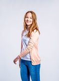 Girl in jeans and cardigan, woman, studio shot Stock Images