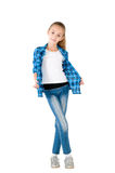 The girl in jeans and a checkered shirt Royalty Free Stock Photos