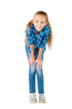 The girl in jeans and a checkered shirt Royalty Free Stock Photo