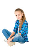 The girl in jeans and a checkered shirt Royalty Free Stock Photography