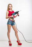 Girl in jeans chert. keeps working tools. drill stock images