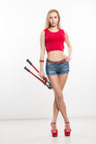 Girl in jeans chert. keeps working tools. pliers Stock Photo