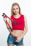 Girl in jeans chert. keeps working tools. pliers Royalty Free Stock Image