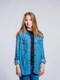 Girl in jeans and denim shirt, woman, studio shot Royalty Free Stock Photo