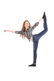 Girl in jeans doing acrobatic stunt. On white Royalty Free Stock Images