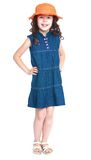 Girl in jeans dress and hat Royalty Free Stock Photos