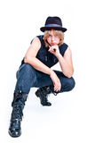 Girl in jeans, hat and black jacket  Stock Photography
