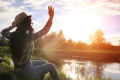A girl travels the summer in the country. A girl in jeans and a hat travels the summer in the countryr Stock Images