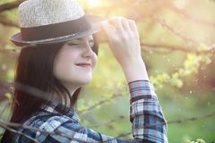 A girl travels the summer in the country. A girl in jeans and a hat travels the summer in the countryr Stock Photos