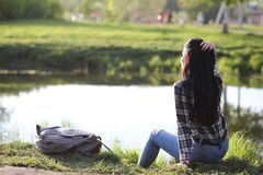 A girl travels the summer in the country. A girl in jeans and a hat travels the summer in the countryr Royalty Free Stock Photo