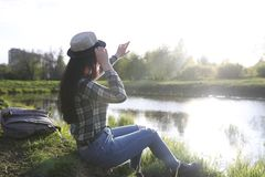 A girl travels the summer in the country. A girl in jeans and a hat travels the summer in the countryr Royalty Free Stock Photos