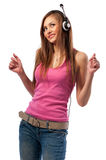 Girl in jeans and headphones Royalty Free Stock Photography