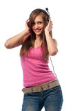 Girl in jeans and headphones Royalty Free Stock Photo