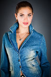 Girl in a jeans jacket Stock Image