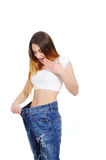 Girl in jeans large size on a white background Stock Photography