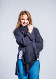Girl in jeans and long sweater, woman, studio shot Stock Photos