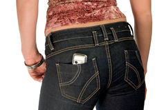 Girl in jeans with mobile. Silver mobile phone in jeans pocket Stock Image