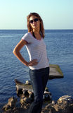 Girl in jeans near sea Stock Photography