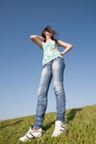 Girl in jeans outdoors Stock Image