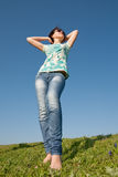Girl in jeans outdoors Stock Photography