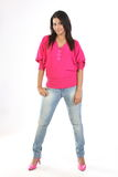 Girl with jeans pant and pink tops Royalty Free Stock Image