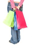 Girl in jeans with shopping bags Royalty Free Stock Photography