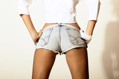 Girl in jeans shorts Royalty Free Stock Photos