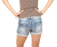 Girl in jeans shorts Stock Images